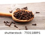 many dry cloves spice on brown... | Shutterstock . vector #753118891
