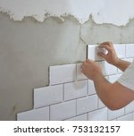 tiling the tiles in the kitchen | Shutterstock . vector #753132157