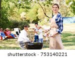 woman cooking tasty sausages...   Shutterstock . vector #753140221