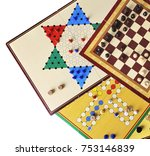 Small photo of Various board games of ludo, halma, chess and fox and geese isolated on white