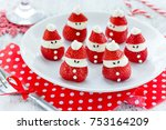 Small photo of Christmas fun food idea - strawberry Santa Claus, healthy and delicious treat for kids