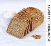 Small photo of Whole wheat grain bread slice slices sliced loaf square on wooden board wood