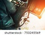 car mechanic balancing car...   Shutterstock . vector #753245569