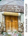 Small photo of Wooden door entrance to the yurt, a traditional nomad house