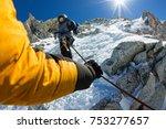 Tied Climbers Climbing Mountain ...