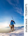a skier is riding and jumping... | Shutterstock . vector #753284971