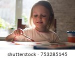 a little girl of three years is ... | Shutterstock . vector #753285145