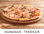 fresh hot pizza with sausages... | Shutterstock . vector #753331225