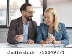two happy coworkers read market ... | Shutterstock . vector #753349771