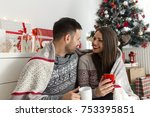 young smiling couple drinking... | Shutterstock . vector #753395851