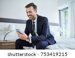 man using phone and sitting on... | Shutterstock . vector #753419215