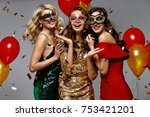 party. beautiful women in masks ... | Shutterstock . vector #753421201