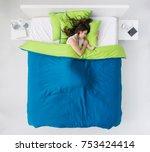 young woman sleeping in her... | Shutterstock . vector #753424414