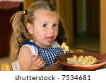 young girl eating pasta | Shutterstock . vector #7534681