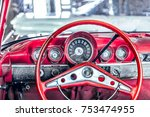 close up to red steering wheel  ...   Shutterstock . vector #753474955