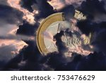 a damaged euro coin shrouded in ... | Shutterstock . vector #753476629