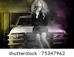 Beautiful blond high fashion model sitting on old car at night shot with colored lights. Retouched by professional fashion and beauty retoucher. - stock photo
