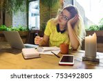 young female student working on ... | Shutterstock . vector #753492805