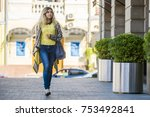 a young girl walks by the store | Shutterstock . vector #753492841
