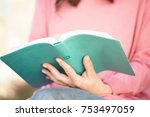 woman reading the bible | Shutterstock . vector #753497059