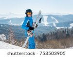 happy female skier smiling to... | Shutterstock . vector #753503905