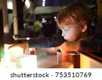 kid studying the refraction of...   Shutterstock . vector #753510769