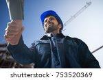 portrait of an engineer shaking ... | Shutterstock . vector #753520369