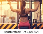 athletic woman using machine... | Shutterstock . vector #753521764