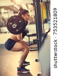 female athlete doing squats... | Shutterstock . vector #753521809
