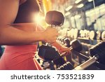 female fitness trainer with... | Shutterstock . vector #753521839