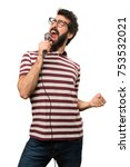 man with glasses singing with... | Shutterstock . vector #753532021
