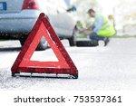 man changing a flat tyre after... | Shutterstock . vector #753537361