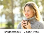 happy woman wearing sweater...   Shutterstock . vector #753547951
