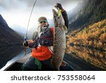 fishing. fisherman and trophy... | Shutterstock . vector #753558064