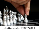 business man hold pawn to first ... | Shutterstock . vector #753577021