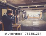 man with weapon try positions... | Shutterstock . vector #753581284