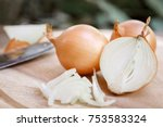 onion and onion slices on... | Shutterstock . vector #753583324