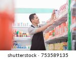 happy young male staff working... | Shutterstock . vector #753589135
