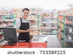 happy young male shopkeeper... | Shutterstock . vector #753589225