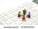miniature 4 people sitting on... | Shutterstock . vector #753592054