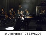 Small photo of New York, NY - November 10, 2017: Evanescence rock band with orchestra performs at Kings Theater of Brooklyn