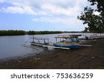 boats lean on mangrove forest | Shutterstock . vector #753636259