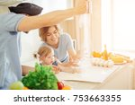 happy family in the kitchen... | Shutterstock . vector #753663355