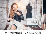 young seamstress sewing a white ... | Shutterstock . vector #753667201