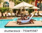 two women sunbathing on sunbeds ... | Shutterstock . vector #753695587