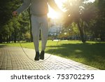 sporty young man jumping rope