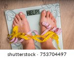 female feet on personal scales... | Shutterstock . vector #753704497