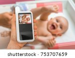 hand of mother is holding baby... | Shutterstock . vector #753707659