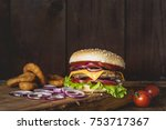 cheeseburger and onion rings on ... | Shutterstock . vector #753717367