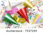 Party cone caps, streamers, pipes and carnival masks shot from above - stock photo